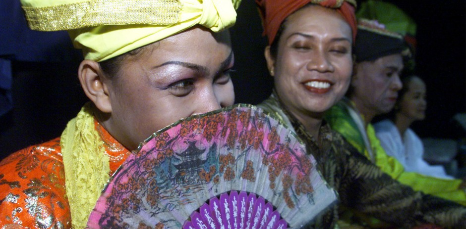 BISSU MEMBERS LISTEN TO THEIR DIRECTOR BEFORE A THEATRICAL PERFORMANCE IN JAKARTA.